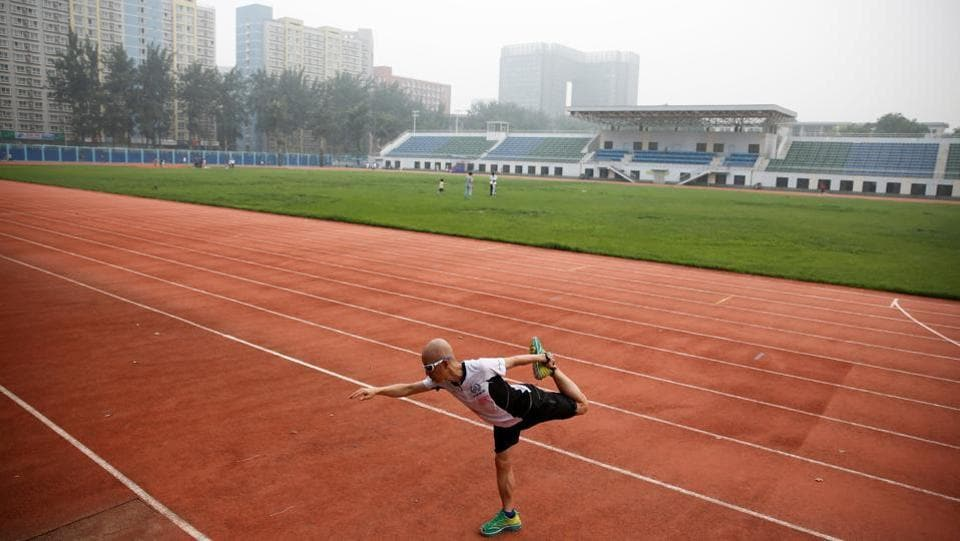 Then there are the runners. Many build their lives, and spending habits, around the sport. He Runyu, a business management professor at Beijing's Science and Technology University, became serious about long-distance running around the same time he gave up meat and drinking. He now averages about 10 races a year, just for fun.  (Thomas Peter / REUTERS)