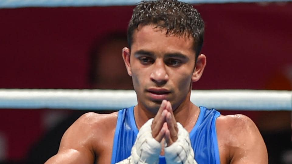 ... was declared winner against Paalam Carlo (unseen) of Philippines in the  Men's Light Fly (46-49kg) boxing semifinal bout at the 18th Asian Games  2018 in ...