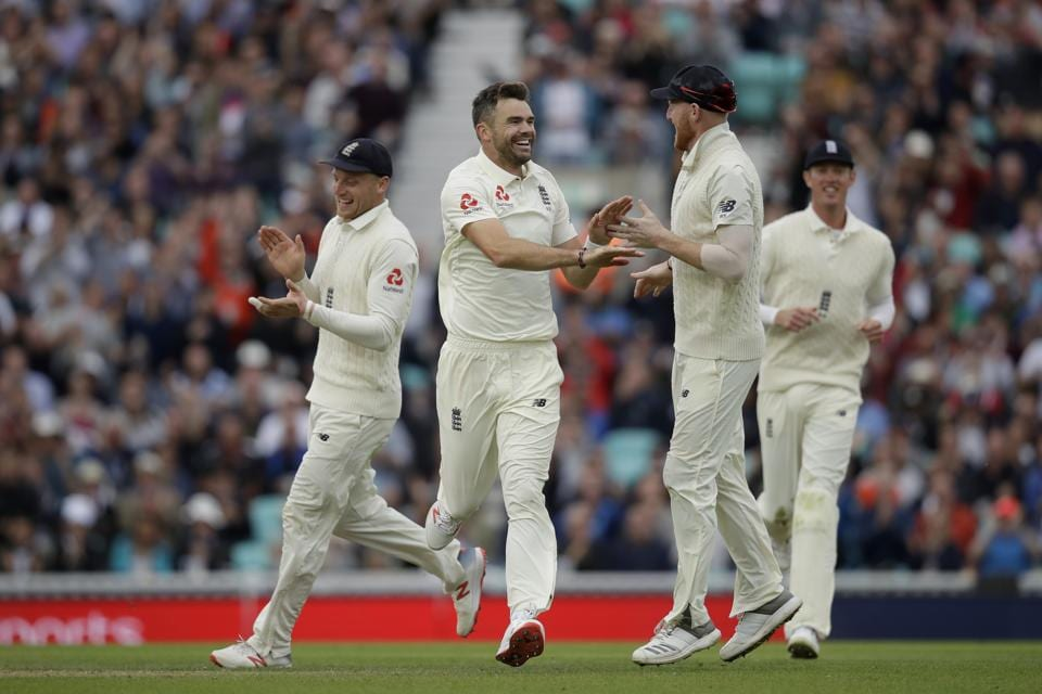 England's Jimmy Anderson, second left, celebrates with his teammates during the second day of the  fifth test match between England and India at the Oval cricket ground (AP)