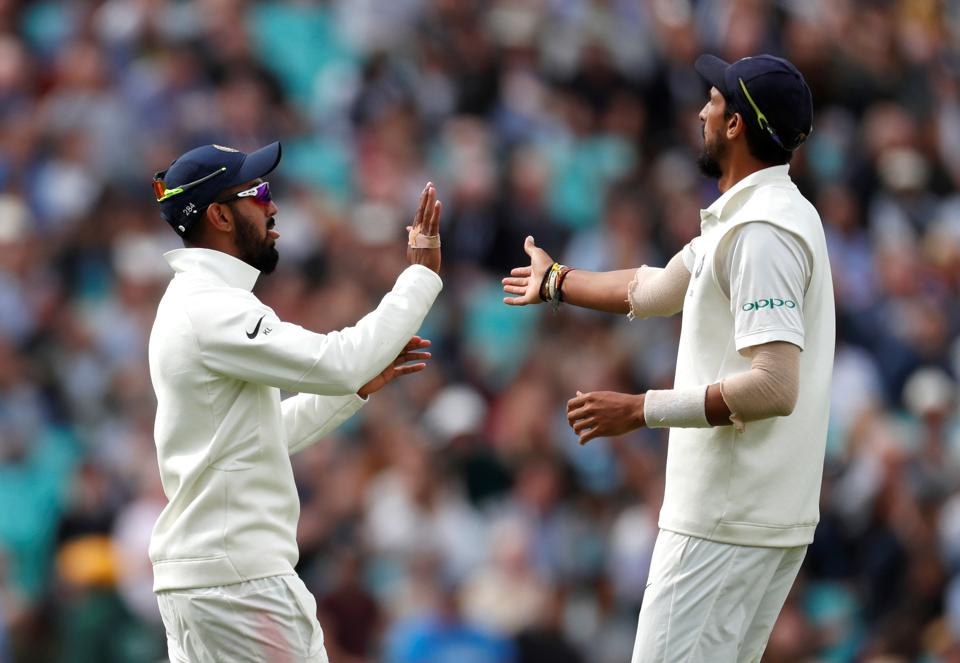 Lokesh Rahul celebrates with Ishant Sharma after England were dismissed during the second day of the  fifth test match between England and India at the Oval cricket ground. (REUTERS)