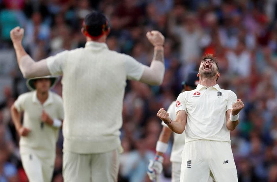 James Anderson celebrates taking the wicket of India's Cheteshwar Pujara during the second day of the  fifth test match between England and India at the Oval cricket ground. (REUTERS)