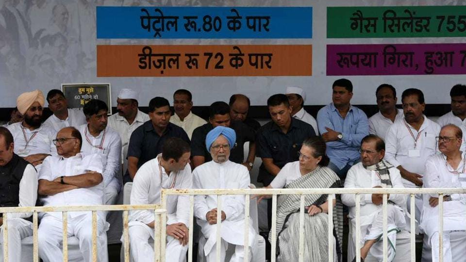 """Modi government has done a number of things that were not in the interest of the nation. The time to change this government will come soon,"" said former PM Manmohan Singh who along with UPA chairperson Sonia Gandhi joined the Congress-led bandh protest at Ramlila Maidan. They were later joined by AAP leader Sanjay Singh who had earlier refused to join the protest. (Sonu Mehta / HT Photo)"