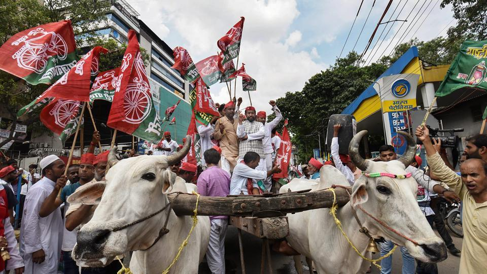 Samajwadi Party activists raise slogans holding their party flags during Bharat Bandh in Patna . The shutdown evoked partial response in Telangana and Andhra Pradesh. Bus services were affected since early morning in both the states. Many private educational institutions also remained closed. (PTI)