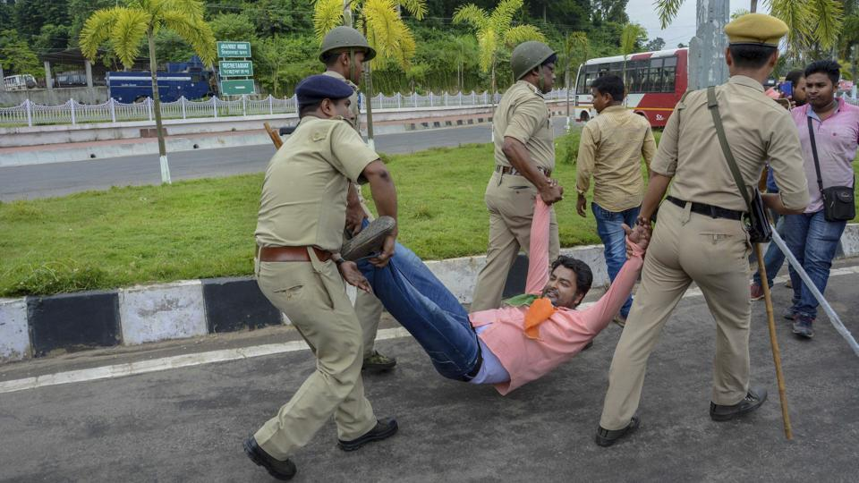Policemen detain a Congress party worker during a protest in Agartala. The BJP however dubbed the 'Bharat Bandh' call as an attempt to spread rumour and confusion among the masses. (PTI)