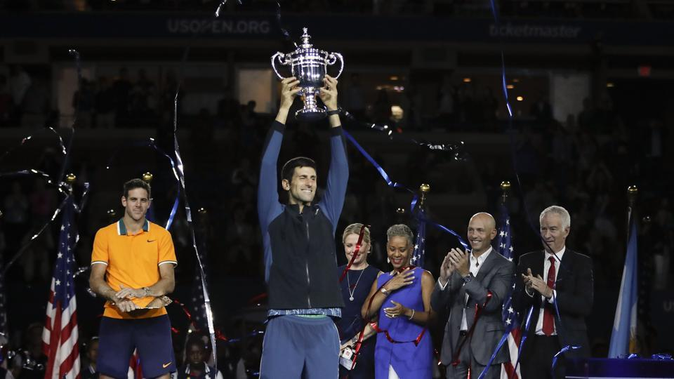 Novak Djokovic, of Serbia, holds up the championship trophy after defeating Juan Martin del Potro, of Argentina, during the men's final of the U.S. Open tennis tournament, Sunday, Sept. 9, 2018, in New York.