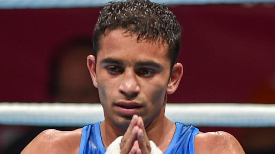 Amit Panghal gestures after winning the gold medal in boxing at the Asian Games 2018.