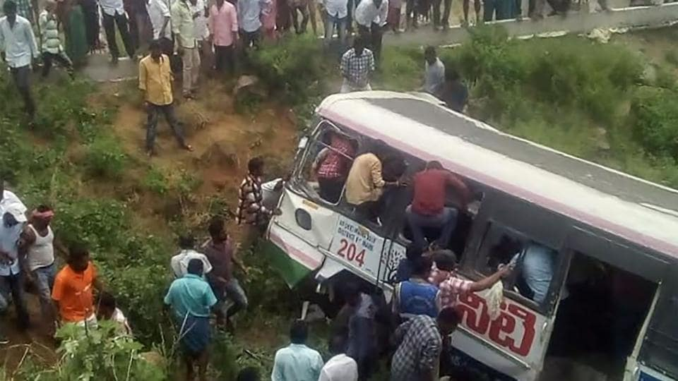 At least 52 people were feared killed and several others injured when a state-owned bus fell into a gorge in Telangana's Jagtial district on Tuesday, police said. The bus belonging to Telangana State Road Transport Corp fell off Kondagattu Ghat Road while returning from a Hanuman temple atop Kondagattu Hills. The bus was carrying around 60 passengers. (AFP)