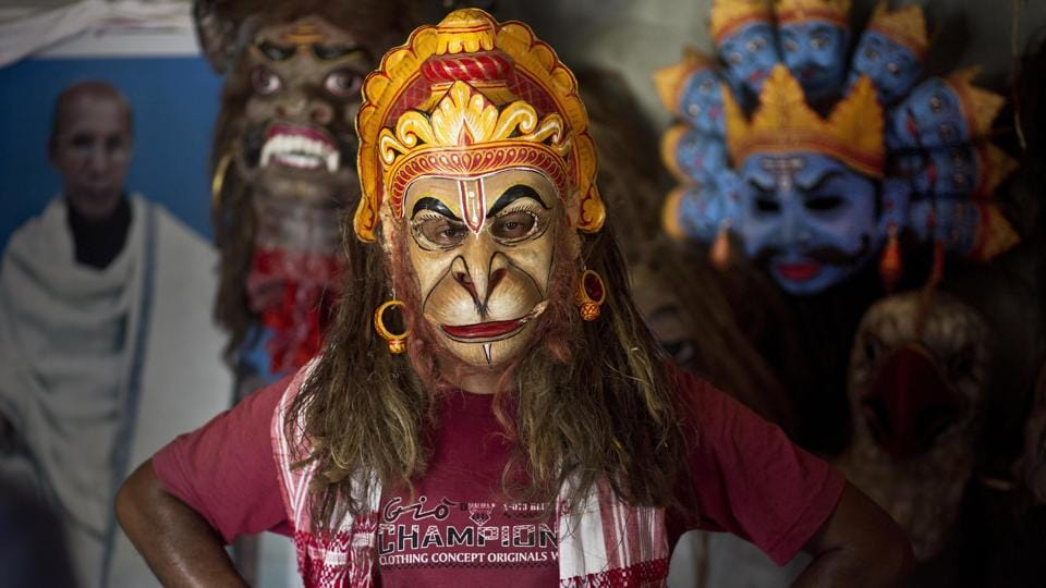 Artist Khagen Goswami wears a Hanuman mask. Not just 'bhaona' and 'satriya' dance, the Satra was used as an experimental ground by Shankareva and his students to spread knowledge of language, literature, education and industry. Apart from training in the arts and praying, the Satras also provide the young monks a secular education and teach them skills like to cooking and farming. (Anupam Nath / AP)