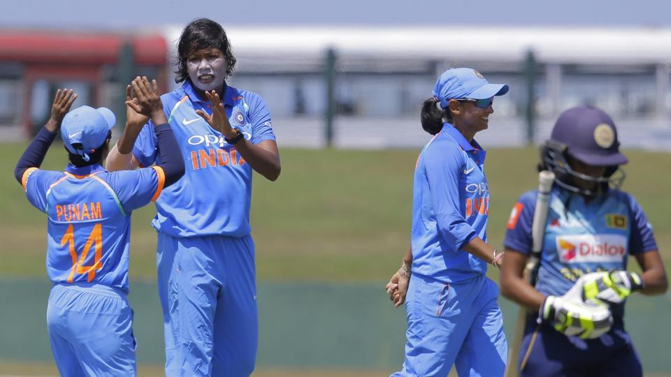 Jhulan Goswamy (2L) celebrates after taking the wicket of Sri Lanka's Nipuni Hansika (R) during the first one day international women's cricket match in Galle, Sri Lanka. India won the match by nine wickets after bundling Sri Lanka out for 98. (AP)