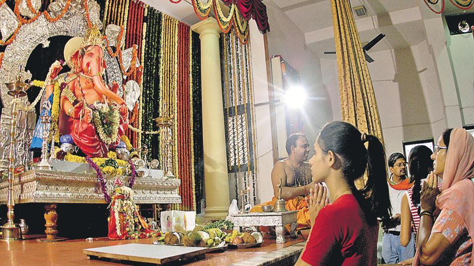 Residents worship at a Ganesh pandal in Delhi's Rajinder Nagar.
