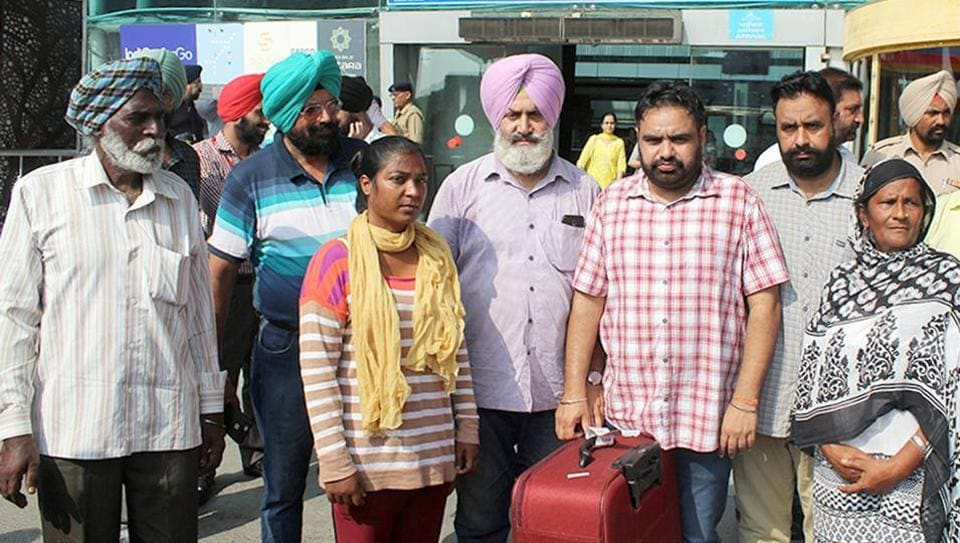 Parveen Rani with her mother Simarjit Kaur, father Joginder Singh and other family members at Sri Guru Ram Dass Jee International Airport in Amritsar on Monday.
