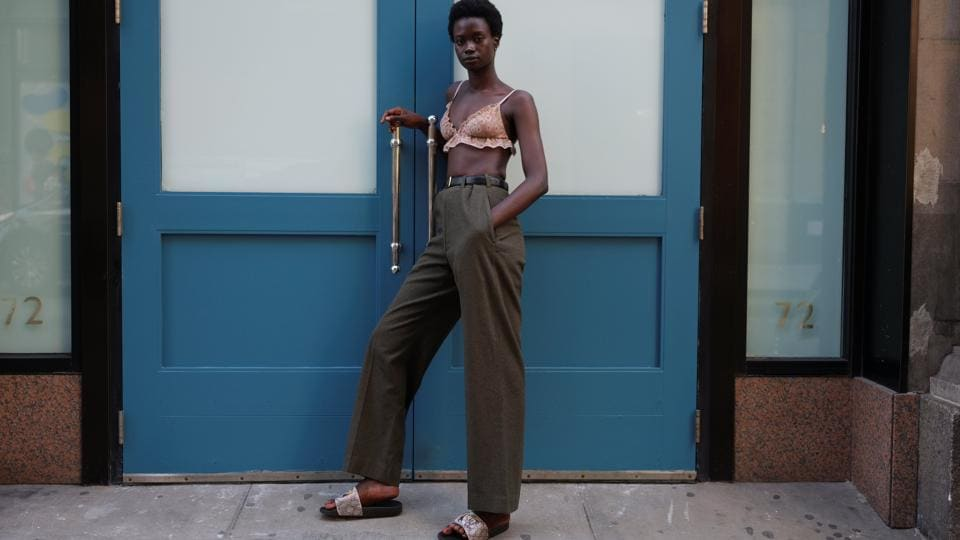 """Fatou Jobe, 24, a model based in New York, poses for a portrait in the Manhattan borough.  """"I'm very in between 1965 and 2030... I love thrifting, but I do walk (model) for big names,"""" Jobe said. """"I'm fascinated by the designs and designers. I never thought I would be the type of person to buy expensive clothes... but I'm inspired."""" (Caitlin Ochs / REUTERS)"""