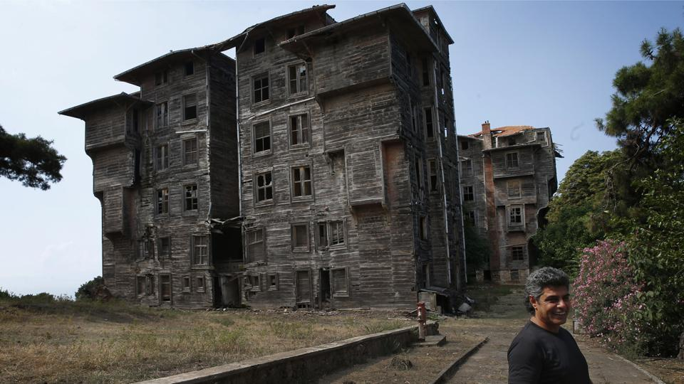 Each morning, Erol Baytas, 56, checks for further damage on the imposing but derelict timber building in Buyukada, the largest and most popular of the Princes' Islands in the Sea of Marmara near Istanbul that for decades housed orphans from the minority Greek community. (Lefteris Pitarakis / AP)