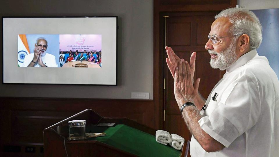 PM Narendra Modi interacts with the ASHA, Anganwadi and ANM workers from all over the country through video conference in New Delhi. Modi on Tuesday announced a hike in their monthly honorarium from October, coverage of various social security schemes and provided free insurance cover under Pradhan Mantri Jeevan Jyoti Bima Yojana and Prime Minister Suraksha Bima Yojana. (PTI)