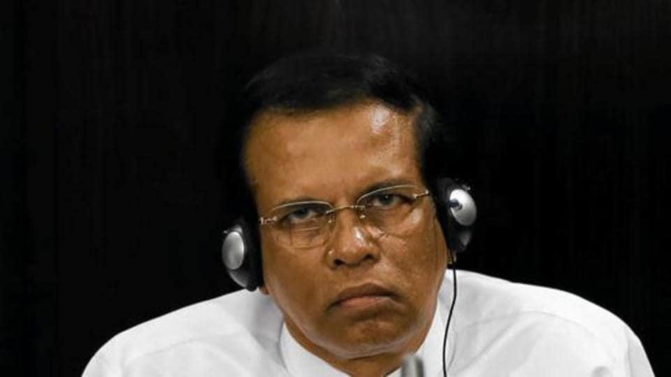 Sri Lanka's President Maithripala Sirisena listens to a speech during a Parliament session marking the 70th anniversary of Sri Lanka's Government, in Colombo.