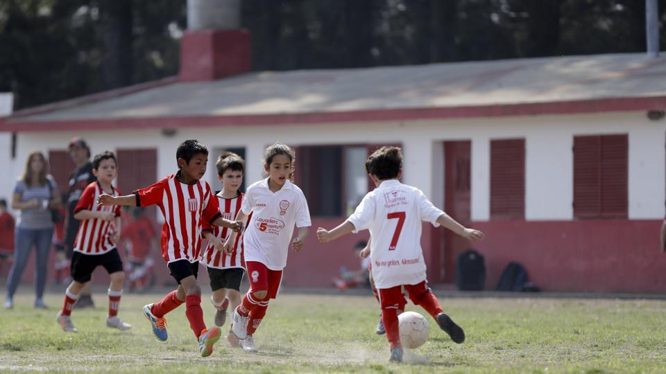 At age 7, Candelaria Cabrera goes after the ball with determination. She drives toward her rivals without caring much about getting hurt and deftly manages the bumps on the dirt field. She wears a loose white jersey from Huracan de Chabas, her hometown. Her long, copper coloured hair tied in a ponytail distinguishes her from the rest of the players. (Natacha Pisarenko / AP)