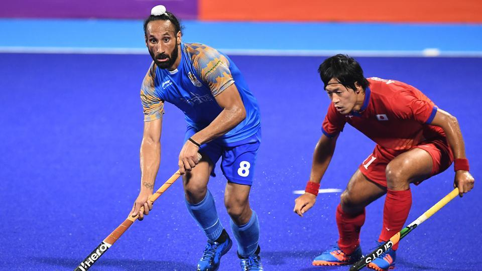 Sardar Singh of India #8 fights for the ball against Kenji Kitazato of Japan #11 during Men's Hockey Pool A Preliminary Round match between Japan and India on day six of the Asian Games on August 24, 2018 in Jakarta, Indonesia.