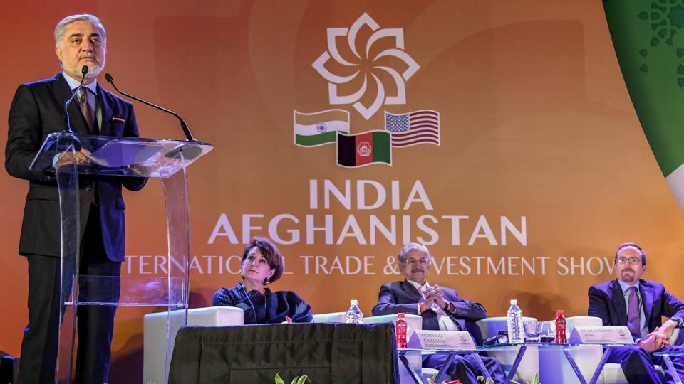 Afghanistan's Chief Executive Abdullah Abdullah (L) speaks at the 'Passage to Prosperity' India-Afghanistan Trade and Investment Show in Mumbai on September 12, 2018.