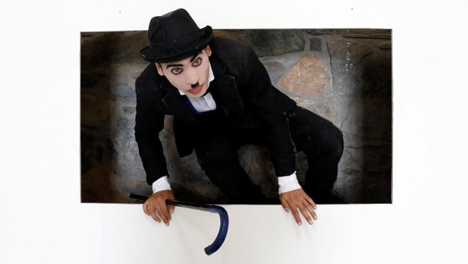 Karim Asir, a Charlie Chaplin impersonator, exercises during his rehearsals in Kabul. Afghanistan's Chaplin says he has witnessed suicide attacks, explosions and threats from hardline Islamic militant groups, but is determined to waddle and bumble to fulfil the primary goal of his life.  (Mohammad Ismail / REUTERS)