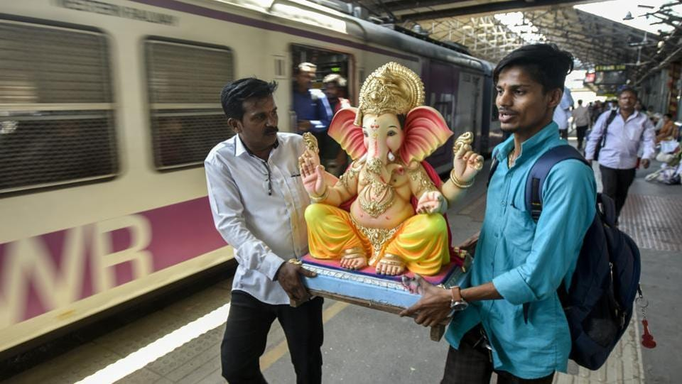 Devotees carry an idol of the Hindu god Ganesha from a workshop to a place of worship at Dadar in Mumbai. Devotees of Ganesha look forward all year to Ganesh Chaturthi or Ganeshotsav, a 10-day festival during which Ganesha idols are brought home or to public pandals and followed by ten days of festivities. (Kunal Patil / HT Photo)