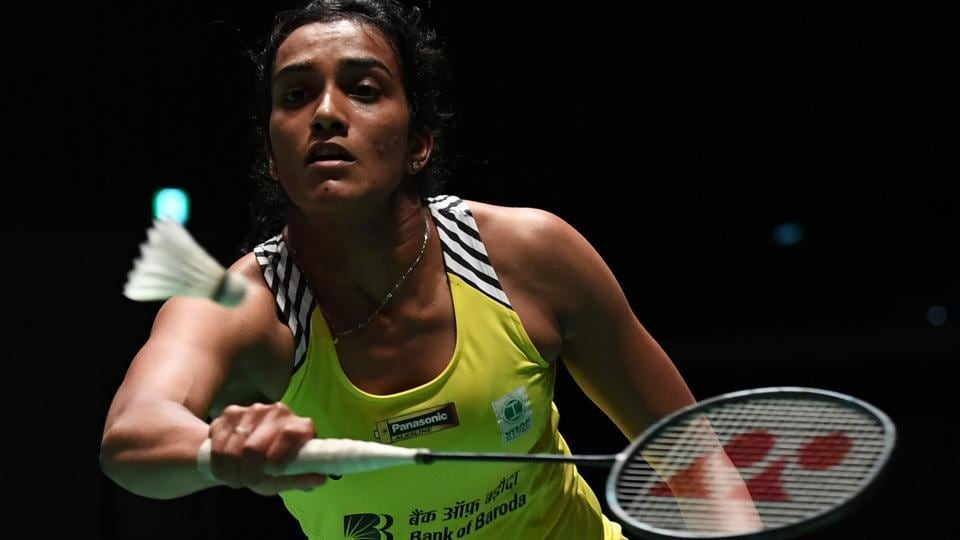Pusarla Venkata Sindhu hits a return towards China's Gao Fangjie during their women's second round match at the Japan Open badminton championships in Tokyo. Fatigue caught up with India's premier shuttler P V Sindhu as she was upstaged in straight games but Kidambi Srikanth entered quarterfinals on Thursday. (Toshifumi Kitamara / AFP)