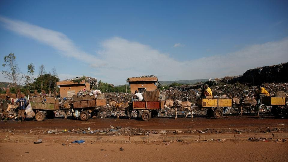 Donkey carts stand in line as they prepare to unload at a local waste transfer station. The population boom has made the issue of waste disposal in Bamako more acute, requiring Diabate's boss, Moustapha Diarra, to deploy eight donkey carts in his district instead of the two he managed a decade ago. (Luc Gnago / REUTERS)
