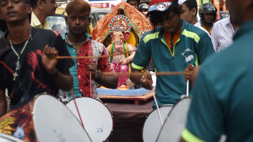 Devotees play drums as they transport an idol of the elephant-headed Hindu deity Ganesh for the Ganesh Chaturthi festival in Mumbai. The ten day festival which began on Thursday will come to a close with the immersion of idols on September 23. (Punit Paranjpe / AFP)
