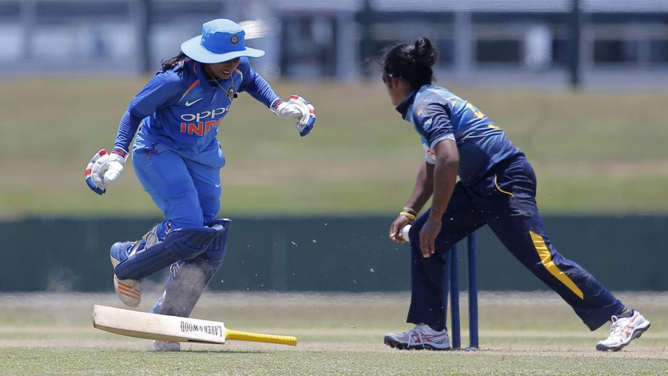 Mithali Raj drops her bat while completing a run as Sri Lanka's Chamari Atapattu attempts to break the wicket during their second women's one day international cricket match in Galle, Sri Lanka. Chasing a target of 220, Sri Lanka need 81 runs in 75 balls to level the series. (Eranga Jayawardena / AP)