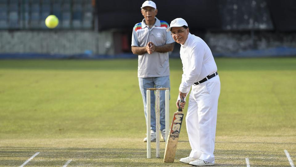 Chief Justice Dipak Misra plays a shot during an annual cricket match between Chief Justice of India-XI and Supreme Court Bar Association-XI in New Delhi on September 12, 2018. (Ravi Choudhary / PTI)