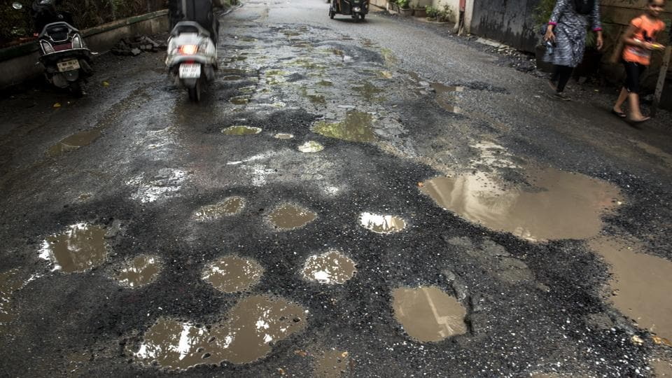 Government statistics show that potholes were responsible for the deaths of 3,597 people across India last year, an average of 10 a day. Citizens blame government apathy, accusing local authorities of failing to maintain roads properly while activists said contractors hired to repave roads do a bad job on purpose so the work will need to be done again the following year. (Satish Bate / HT File)