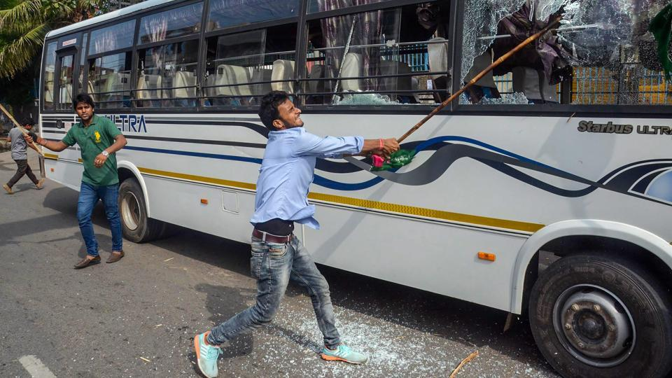 A Jan Adhikar Party supporter vandalises vehicles during 'Bharat Bandh' protest against fuel price hike and depreciation of the rupee in Patna, Bihar on September 10, 2018. (PTI)