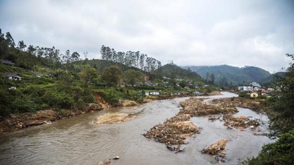 Debris from a landslide sits in a river that runs near tea estates near Munnar in Idukki district of August 25.