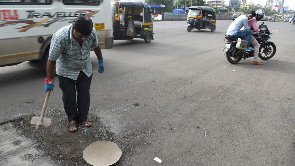 """The government needs to take responsibility and create better infrastructure,"" urges Bilhore. He said that  he has repaired 585 potholes, many of them alone; others with the help of volunteers who are inspired by his story. Bilhore has been featured in various articles and received several awards, earning him the nickname ""pothole dada."" (Indranil Mukherjee / AFP)"