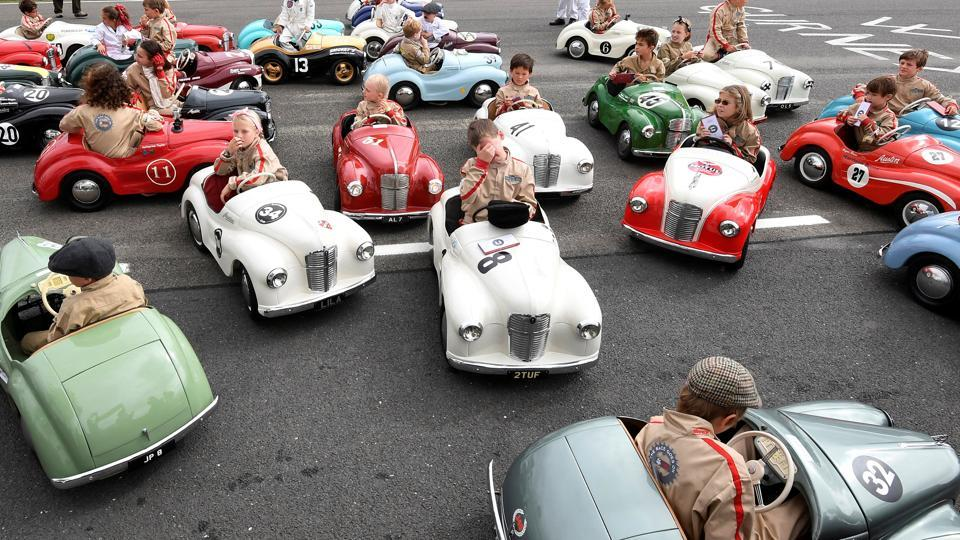 Children react after competing in a pedal car race as motoring enthusiasts attend the Goodwood Revival, a three day classic car racing festival celebrating the mid-twentieth century heyday of the sport, at Goodwood in southern England. (Toby Melville / REUTERS)