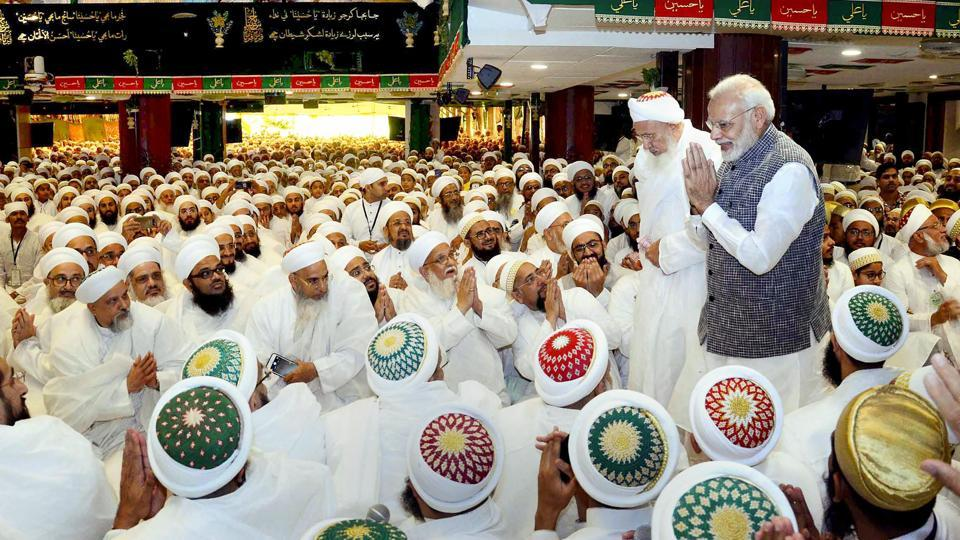 PM Narendra Modi greets members of Dawoodi Bohra community during the 'Ashura Mubarak' programme in Indore. PM Modi said on Friday 'Vasudhaiva Kutumbakam' or concept of the world as one family gives India an identity that is different from other countries as he praised the Bohra community. Modi said the Bohras are known for their honesty in trade and have set an example for others. (PTI)