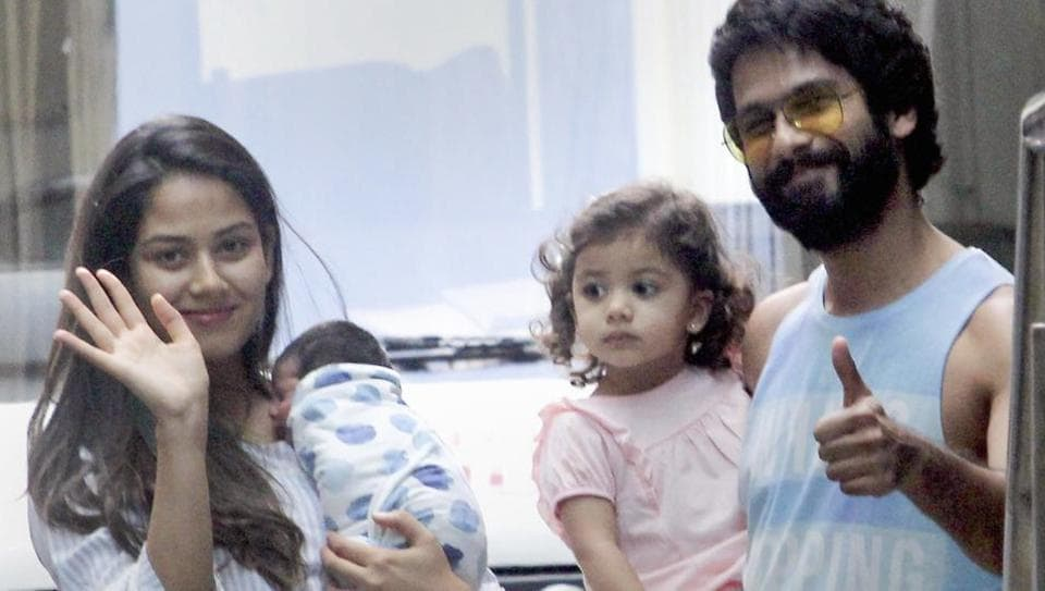 Shahid Kapoor and his wife Mira Rajput with their newborn son Zain and daughter Misha Kapoor pose after getting discharged from the hospital in Mumbai on September 8, 2018.