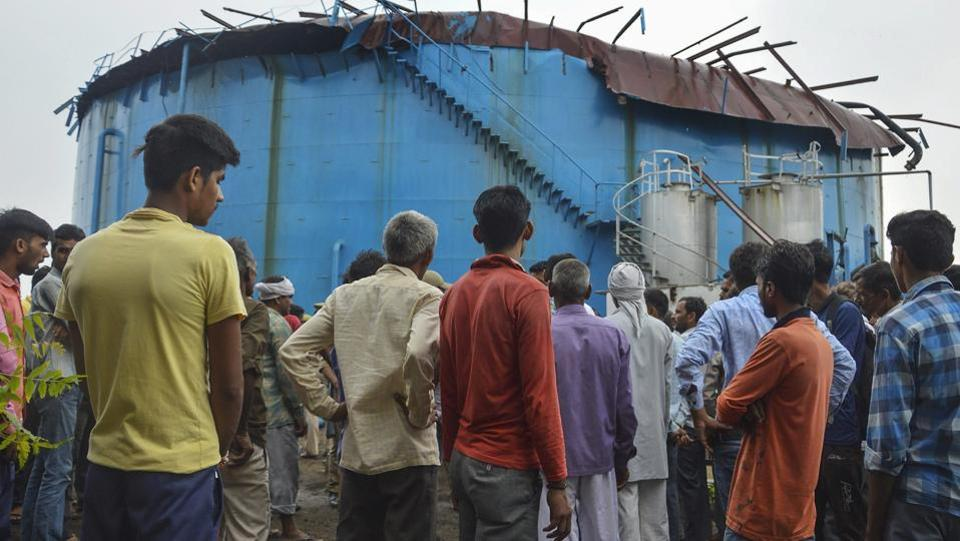 People stand near the site of explosion at a petro-chemical factory where a methane gas boiler tank blast killed six workers in Bijnor, Uttar Pradesh on September 12, 2018. (PTI)