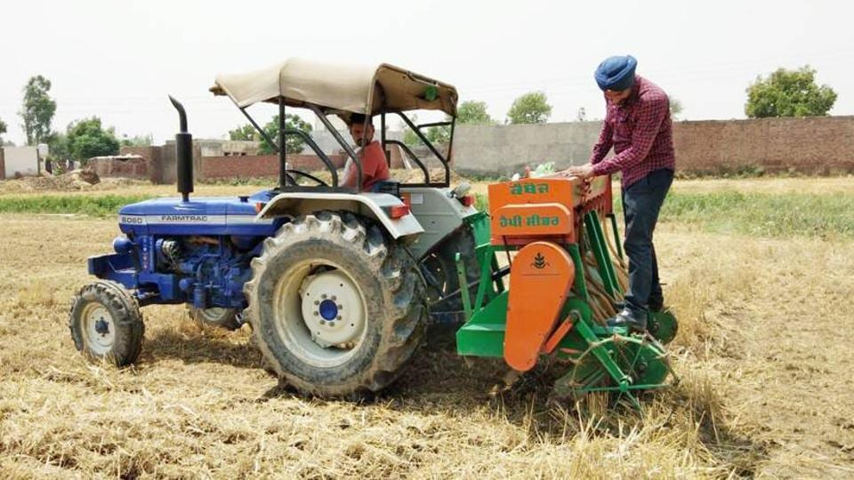 Farmers using happy seeder machine to manage stubble at Bhoewal village in Amritsar.