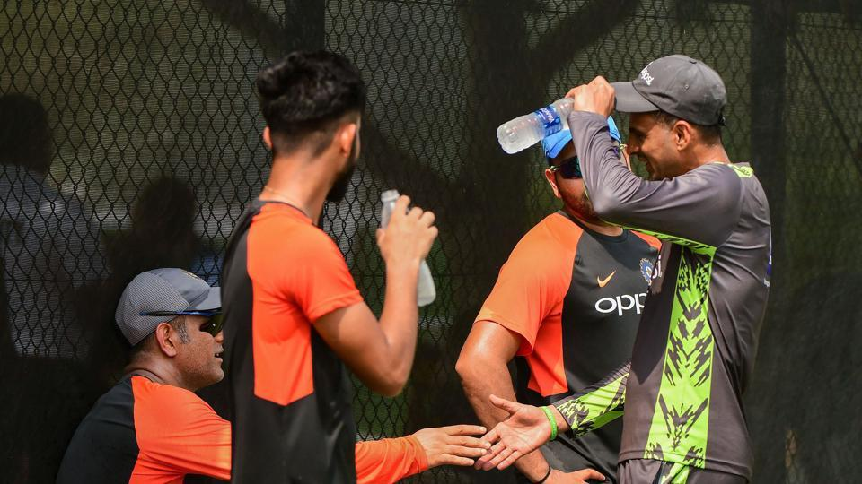 Former Indian cricket team captain Mahendra Singh Dhoni meets Pakistani cricketer Shoaib during net practice ahead of Asia Cup