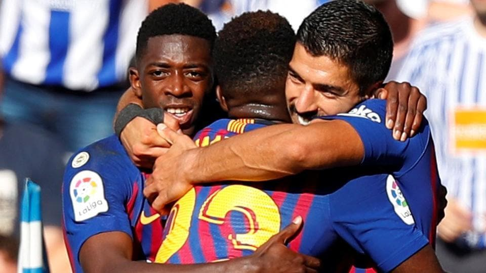 Barcelona's Luis Suarez celebrates scoring their first goal with team mates against Real Sociedad.