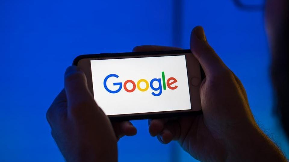 The logo of Google, a unit of Alphabet Inc., sits on an Apple Inc. iPhone smartphone in this arranged photograph in London, U.K., on Monday, Aug. 20, 2018.