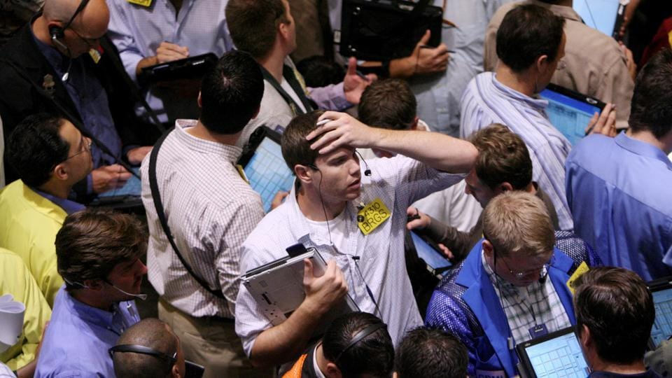 File photo of traders reacting after the US market collapse a decade ago