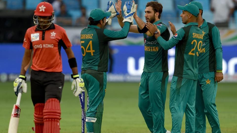 Pakistan cricketer Usman Khan (C) celebrates with teammates after he dismissed Hong Kong batsmans Tanwir Afzal during the one day international (ODI) Asia Cup cricket match between Hong Kong and Pakistan at the Dubai International Cricket Stadium in Dubai on September 16, 2018. (AFP)