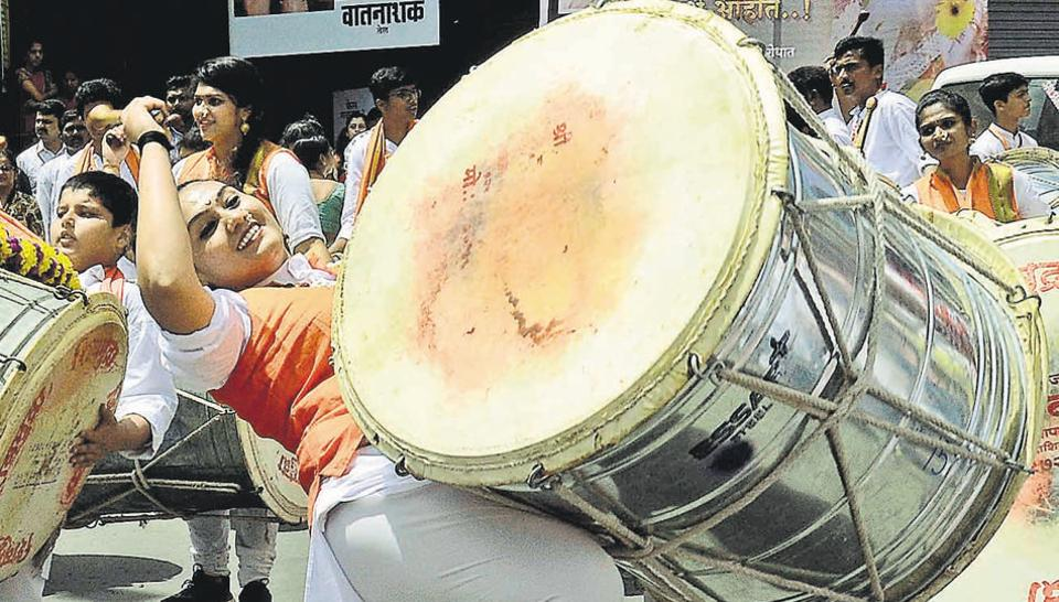 One of the members of Shivamudra dhol tasha troup in front of Kesariwada Ganesh Festival procession in Pune on Thursday. (RAVINDRA JOSHI/HT PHOTO)