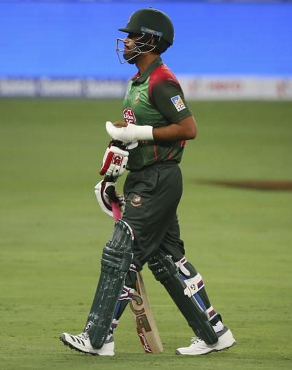 Bangladesh's Tamim Iqbal with his injured left hand covered in an orthopedic cast leaves the field. (AP)