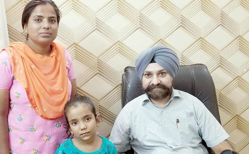 Dr Daljeet Singh with child Gurjot and her mother after successfully removing a clump of hair from Gurjot's small intestine in Ludhiana.