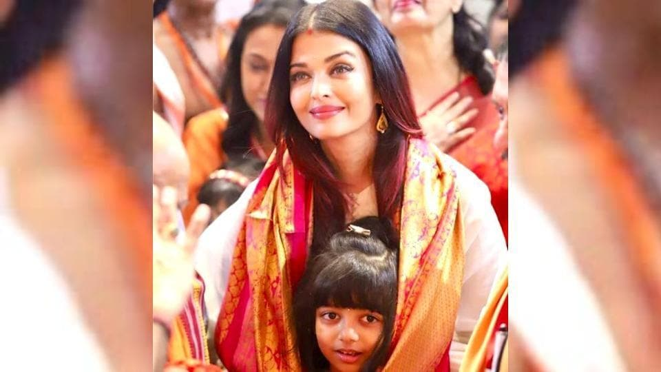 """Aishwarya Rai's Ganesh Chaturthi pic showed her and her darling """"mini-me"""" wrapped up a vibrant red and gold dupatta. (Instagram)"""