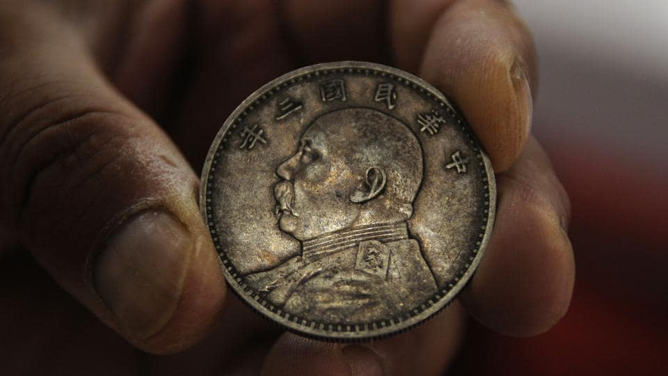 "A coin dating back to late 19th or early 20th century is seen at Munshi Aziz Bhat Museum. ""We definitely need funds for maintenance, better display of artefacts, museum building, art shop but the state government has not listened to our pleas though we have offered to give land for a new museum,"" said Ajaz Munshi. The lack of footfall is another challenge. (Waseem Andrabi / HT Photo)"