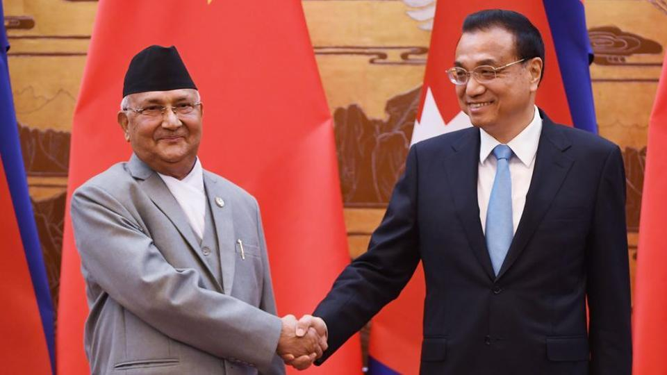 Nepal's Prime Minister K.P. Sharma Oli (L) shakes hands with Chinese Premier Li Keqiang during a signing ceremony at the Great Hall of the People in Beijing on June 21, 2018.