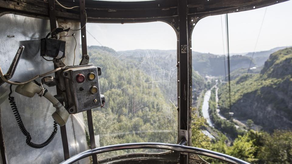 A view of the gorge from a cable car with a soviet era emergency telephone set and buttons in the city of Chiatura. Chiatura, with about 20,000 people, is wedged between steep mountains that hold valuable deposits of manganese. (Evgeniy Maloletka / AP)
